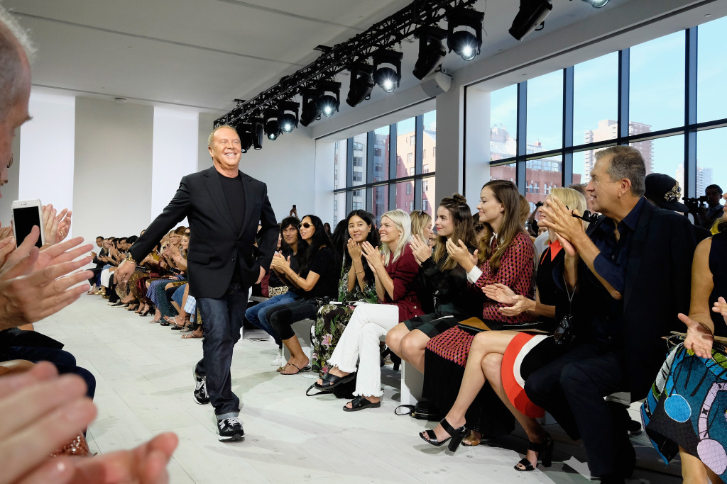 NEW YORK, NY - SEPTEMBER 16:  Designer Michael Kors poses on the runway at the Michael Kors Spring 2016 Runway Show during New York Fashion Week: The Shows at Spring Studios on September 16, 2015 in New York City.  (Photo by Dimitrios Kambouris/Getty Images for Michael Kors)