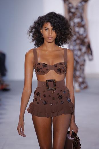 Michael Kors SS17 model on runway wearing bra over top summer trends